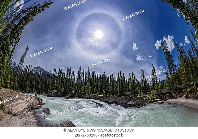 A panorama of a 22° solar halo in the sky over the Natural Bridge and waterfall on the Kicking Horse River in Yoho National Park, BC, June 6, 2016