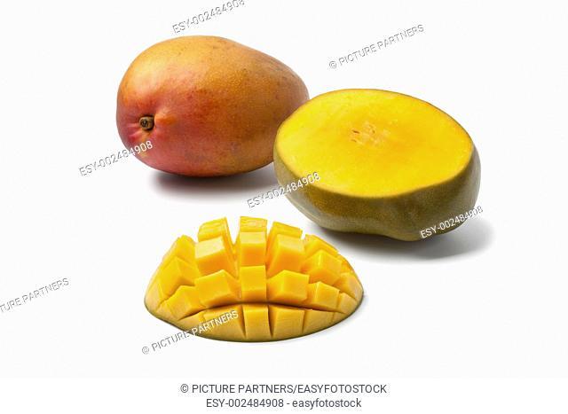 Whole and half Mango on white background