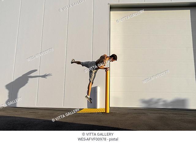 Acrobat training on pole