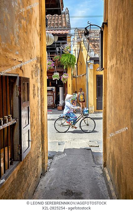 Narrow alley in Hoi An Ancient Town. Quang Nam Province, Vietnam