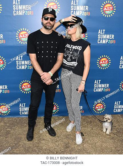 Josh Carter and Sarah Barthel of the band Phantogram pose for a portrait backstage ALT 98.7 Summer Camp at the Queen Mary Event Park in Long Beach on August 3