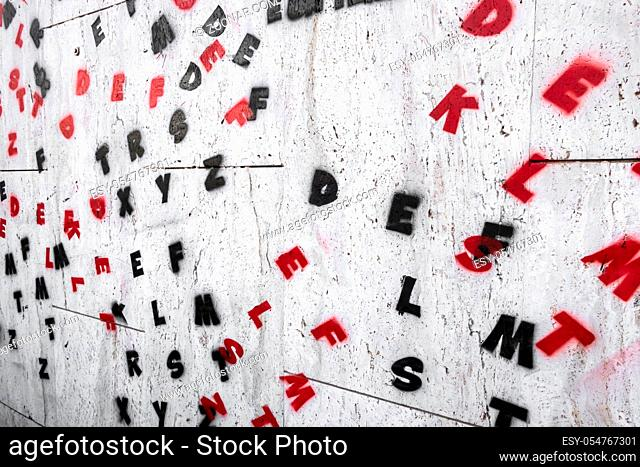 Letters of the alphabet painted on a wall. Ideal for creative concepts and backgrounds