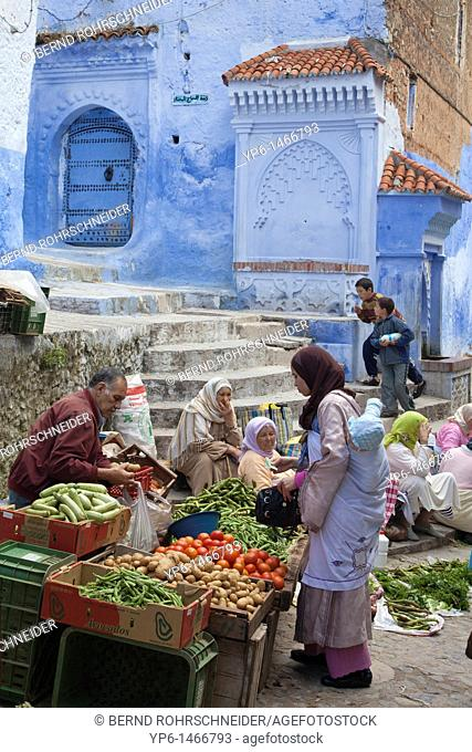 market and blue houses in Chefchaouen, Morocco