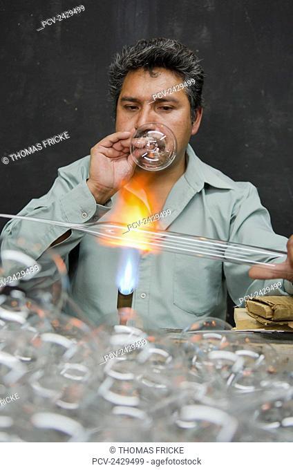 Man blowing and shaping glass; Tlalpujahua, Michoacan, Mexico