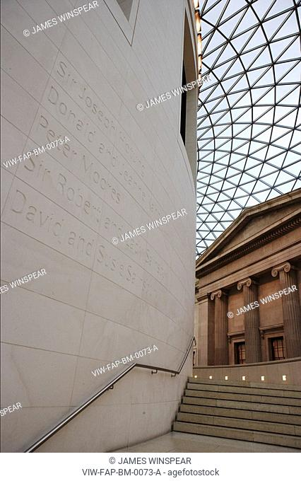 BRITISH MUSEUM GREAT COURT, GREAT RUSSELL STREET, LONDON, WC1 BLOOMSBURY, UK, FOSTER & PARTNERS, INTERIOR, EXTERIOR OF READING ROOM SHOWING TEXT ON STONE WALL...