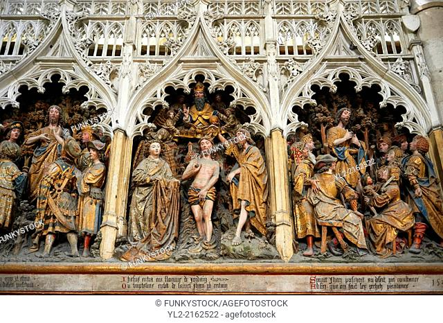 Gothic sculptures depicting scenes from the life of John The Baptist including Christ gbeing baptised. Cathedral of Notre-Dame, Amiens, France