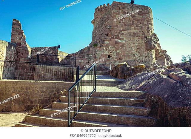 castle with battlements and walls of red stones, Villafamés rural villa in Castellon, Valencia region in Spain