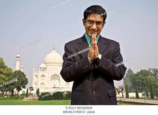 Indian businessman praying at the Taj Mahal
