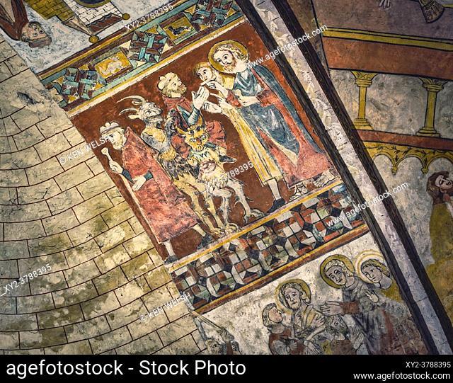 Saint-Macaire, Gironde Department, Aquitaine, France. Romanesque murals on ceiling of Saint Sauveur church. Devils, saints and kings