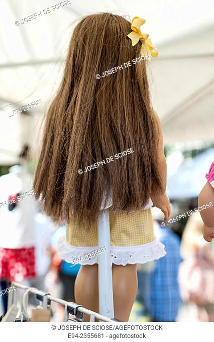 Back view of a doll on display in a store