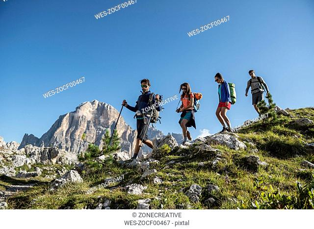 Italy, Friends trekking in the Dolomtes
