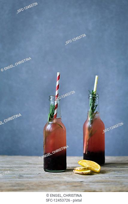 Blueberry and rosemary switchel with ginger in two bottles
