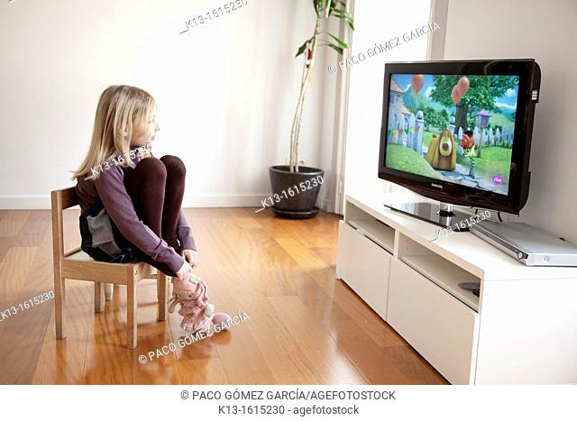 Girl watching TV at home