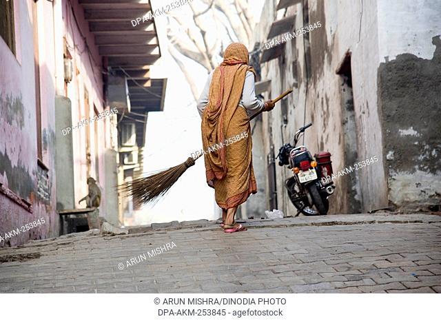 Woman cleaning road, mathura, uttar pradesh, india, asia