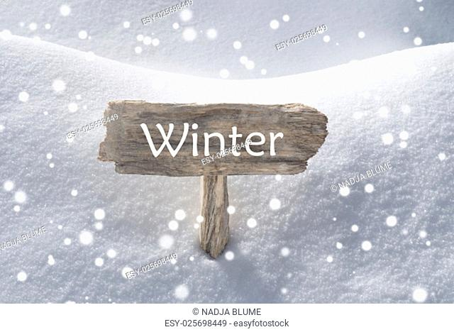 Wooden Christmas Sign With Snow In Snowy Scenery. English Text Winter For Seasons Greetings Or Christmas Greetings. Christmas Atmosphere With Snowflakes