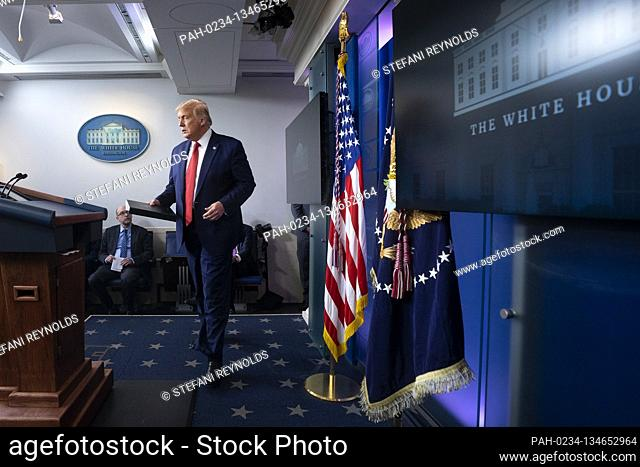 United States President Donald J. Trump arrives to a news conference in the James S. Brady Press Briefing Room at the White House in Washington D.C