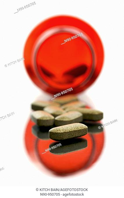 Vitamim tablets in containers isolated and backlit