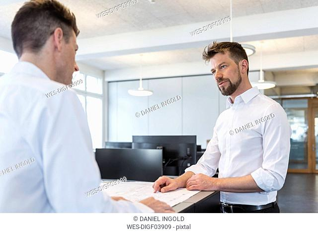 Two businessman having a meeting in office