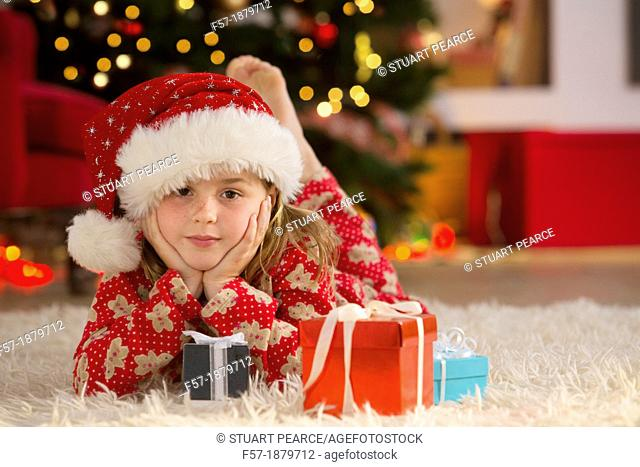 Young girl with gifts at Christmas time