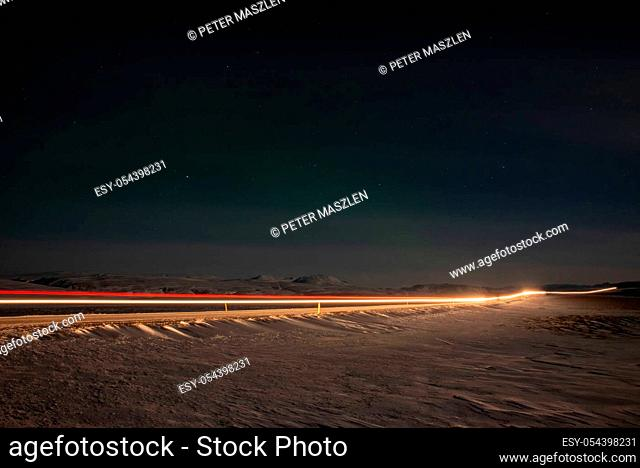 Long exposure of car lights in the night on the Iceland island
