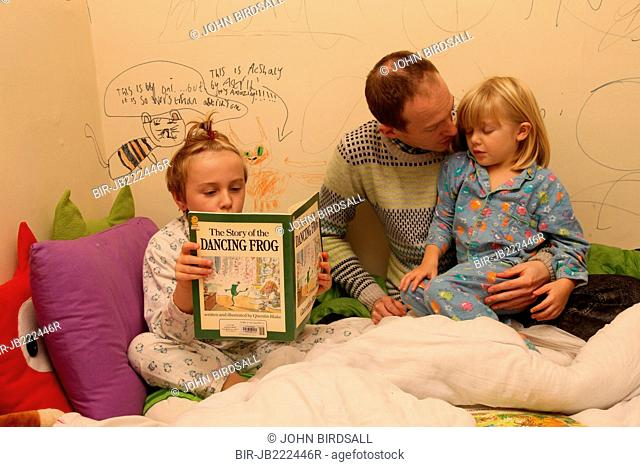 Father and daughters at bedtime