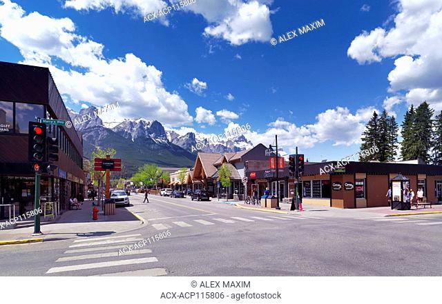 Springtime downtown city scenery of Canmore, town in Alberta Rockies, Bow valley with mountains in the background. Canmore, Alberta, Canada