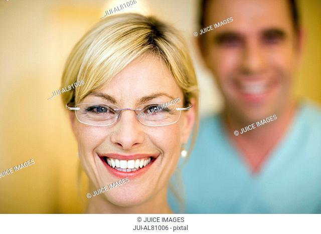 Close up woman wearing eyeglasses and smiling