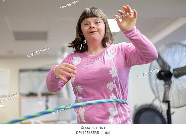 Girl with Down Syndrome using a hula hoop