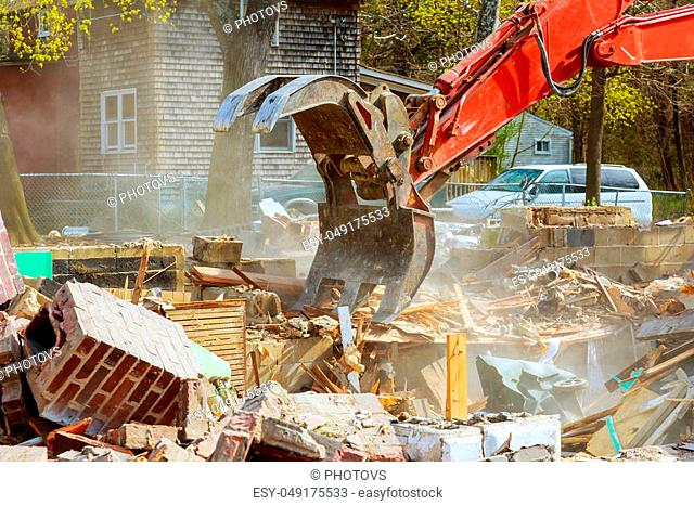 Demolition of an old house, wooden planks and rubble and the ruins of the house for new construction project