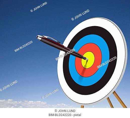 Pen stuck in target bullseye
