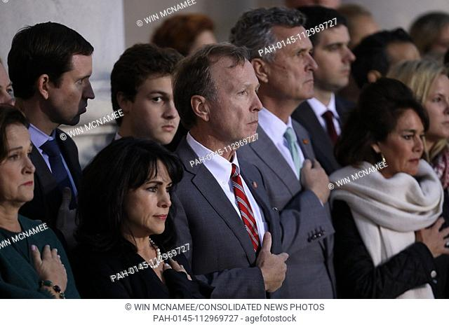 WASHINGTON, DC - DECEMBER 03: Neil Bush (C), son of former U.S. President George H. W. Bush, and members of his family watch as a U.S