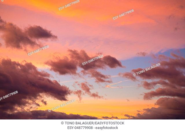 Dramatic sunset sky at colorful dusk blue and orange colors