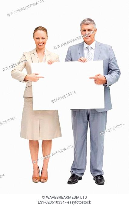 Business people showing a poster