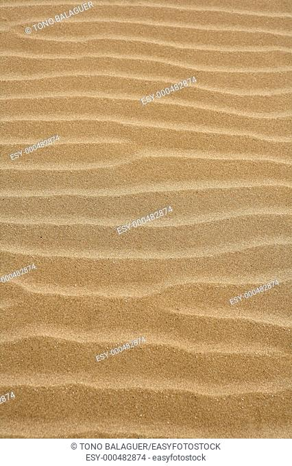 Beach sand waves warm texture pattern background