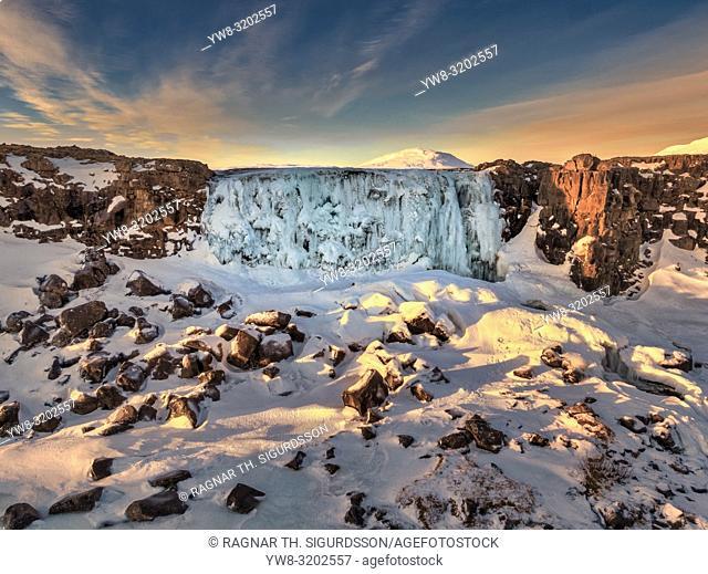 Frozen Oxararfoss waterfall, Thingvellir National Park, Iceland