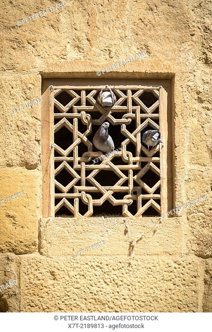 A carved stone window grill in the Great Mosque, La Mezquita, in Cordoba, Spain