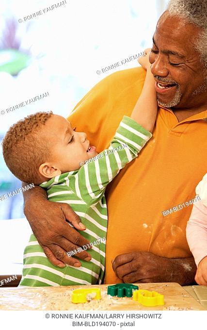 African American man hugging grandson