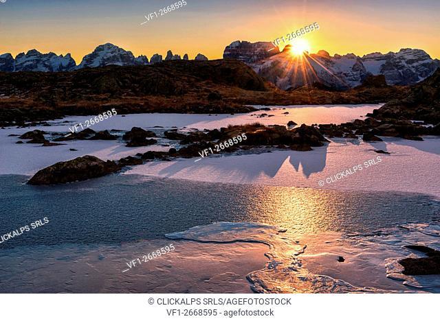 Italy, Trentino Alto Adige, Adamello Brenta Park, Nambrone valley, Dawn at frozen Black Lake, in background Brenta group