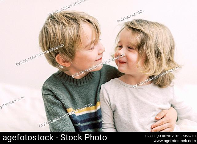 A brother and sister sharing a sweet and happy moment