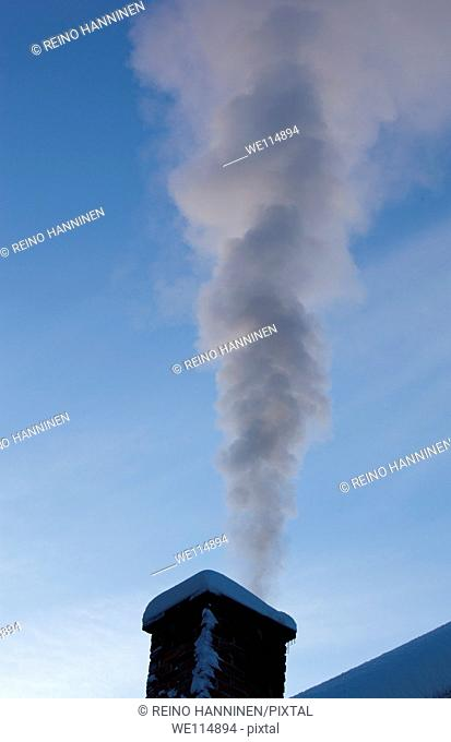 Smoke rising from a smokestack at cold winter evening  Location Suonenjoki Finland Scandinavia Europe