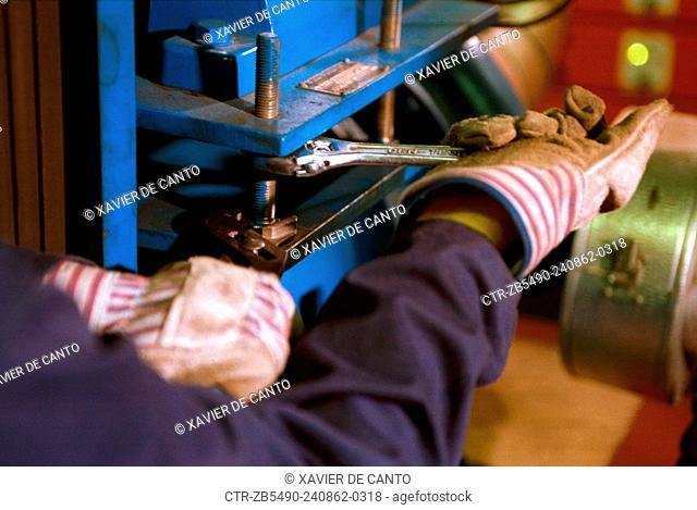 Tightening bolts with spanners