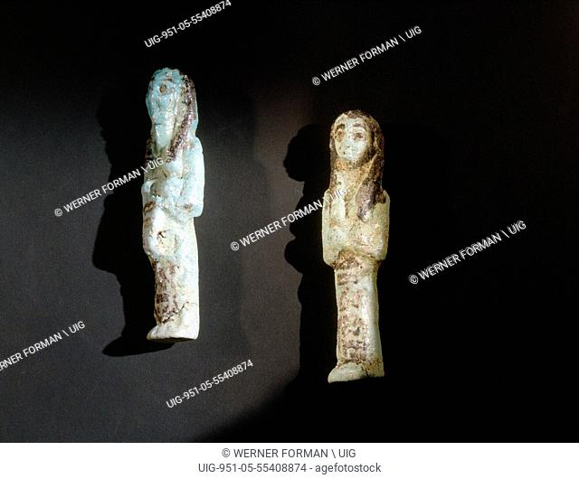 A faience shabti and overseer shabti from the burial of King Siamun