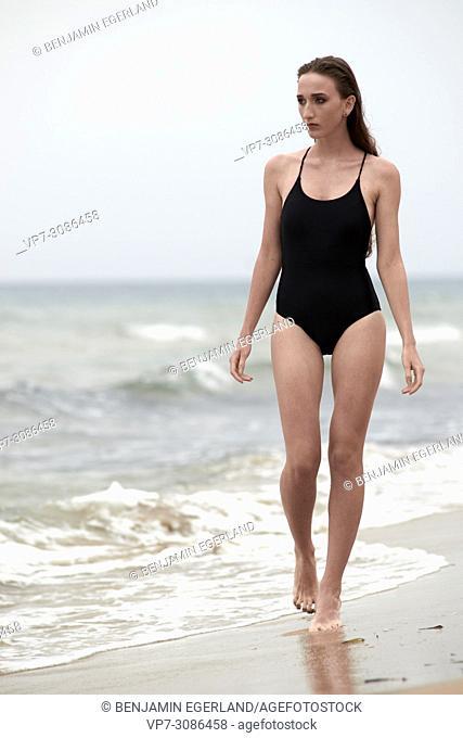 Greece, Crete, Malia, model woman at the beach
