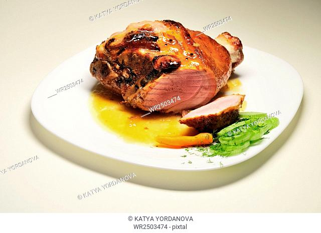 Close-Up Of Roasted Pork Served In Plate