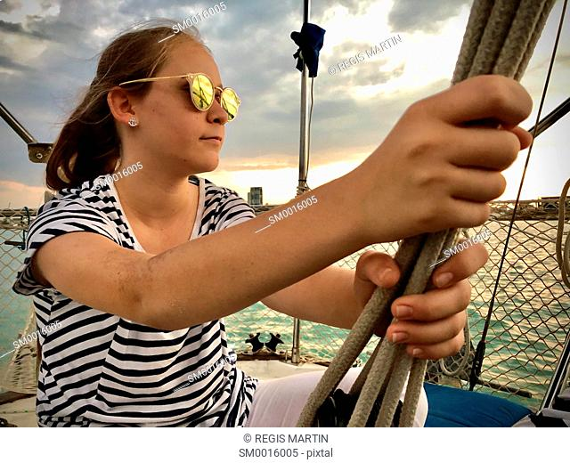 Young girl on a sailing boat