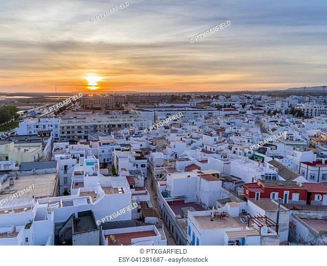 Sunset aerial cityscape in Olhao, Algarve fishing village view of ancient neighbourhood of Barreta, and its traditional cubist architecture. Portugal