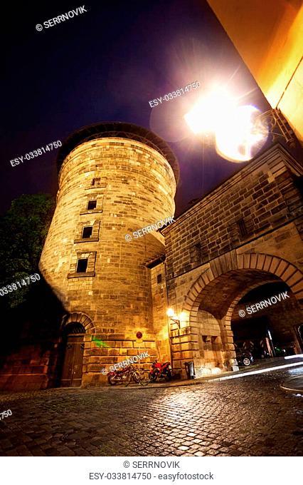 Closer view of Kaiserburg with tower in inner yard, Nuremberg, Bavaria, Germany during night
