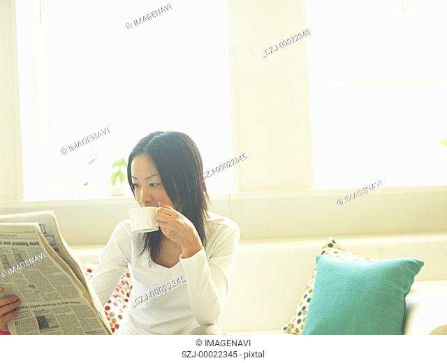 Woman and newspaper
