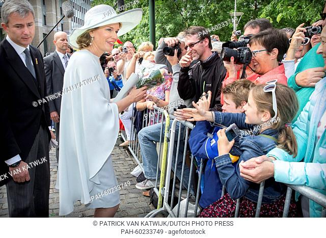 Queen Mathilde of Belgium (L) greets well-wishers after the Te Deum mass at the Cathedral of St. Michael and St. Gudula in Brussels, Belgium, 21 July 2015