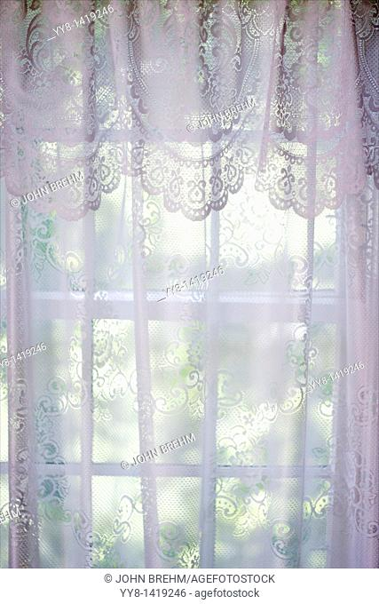 Looking through sheer lace curtain